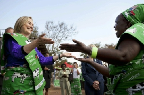 Malawi - Hillary Rodham Clinton dances with Emille Phiri, chair of the Lumbadzi Milk Bulking Group